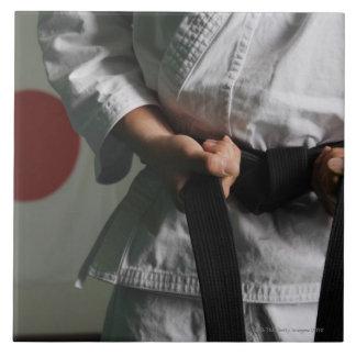 Taekwondo Fighter Tightening Belt Tile