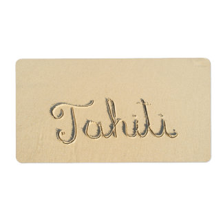 Tahiti carved sign on the beach sand label