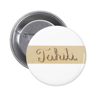 Tahiti carved sign on the beach sand pinback button