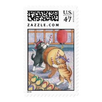 Taiko que teclea los gatos brote y el sello de
