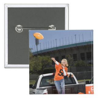 Tailgating woman throwing football pinback buttons