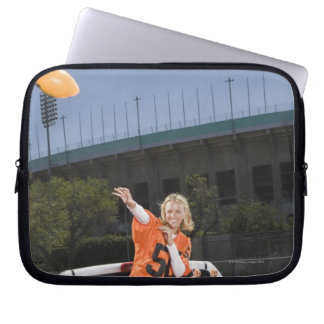 Tailgating woman throwing football laptop computer sleeves