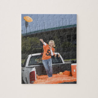 Tailgating woman throwing football puzzle