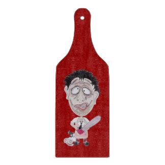 Tajadera de la caricatura del carnicero de la tablas para cortar