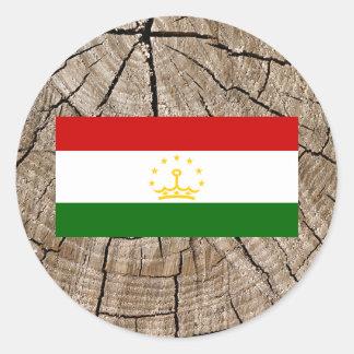 Tajik flag on tree bark classic round sticker