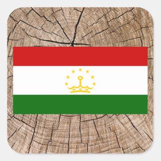 Tajik flag on tree bark square sticker