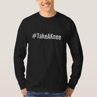 #TakeAKnee, bold white text on black T-Shirt