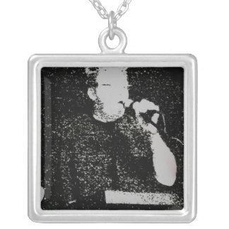 Talking figure black and white abstracted square pendant necklace