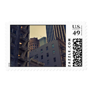 Tall buildings crowd the sky in the city stamps