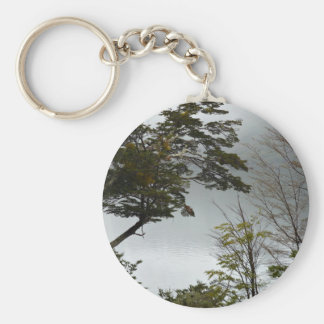 Tall trees overlooking a peaceful lake keychain