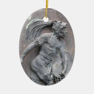 Talla de piedra del guerrero azteca adorno navideño ovalado de cerámica