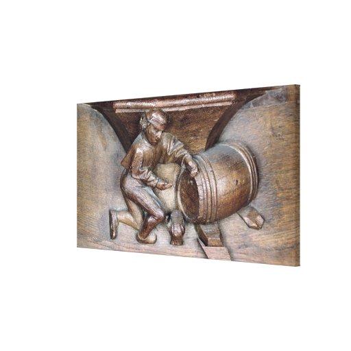 Talla representando a un hombre que pone un golpec impresiones en lona estiradas