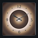 "Tan/Brown Moon Effect Printed Design Square Wall Clock<br><div class=""desc"">A Tan Brown edge with a ring design,  includes a moon effect at the centre.Available in square or round shapes. Numerals are in black,  Roman font.  Please Note > Designers Image has an illuminated effect only and is Not a Led product!</div>"