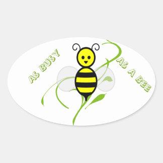 Tan ocupado como una abeja pegatina ovalada
