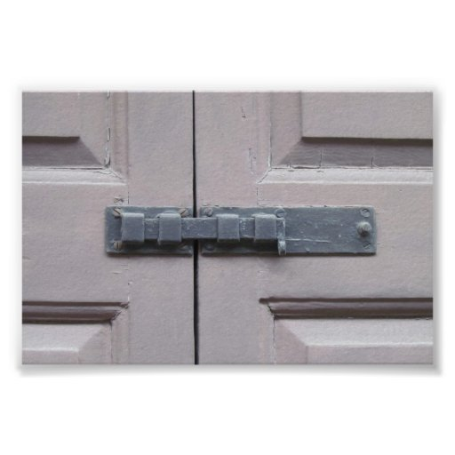 Tan shutter with lock on old house print