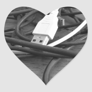 Tangle of dusty computer cables with sockets heart sticker