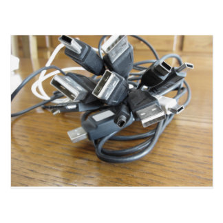 Tangle of dusty computer cables with sockets postcard
