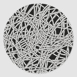 Tangled wires black and white round sticker