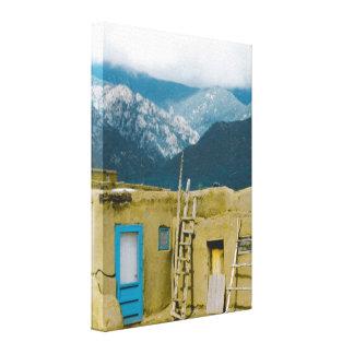 Taos Pueblo And Sangre De Cristo Mountains Canvas Print