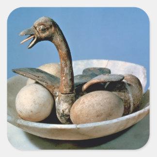 Tapa de un tarro del alabastro adornado con un pegatina cuadrada