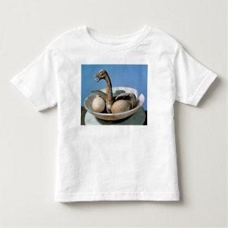 Tapa de un tarro del alabastro adornado con un playera de bebé