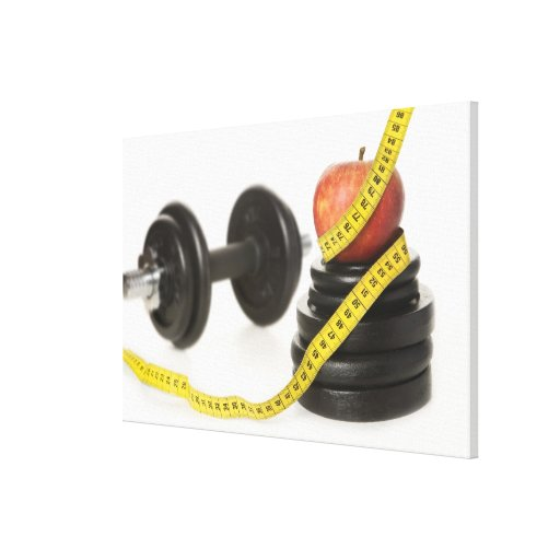 Tape measure, apple, dumbbell and weights canvas print