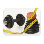 Tape measure, apple, dumbbell and weights rectangular photo magnet