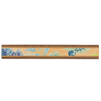 Tapicería floral azul con efecto del brillo regla de arce