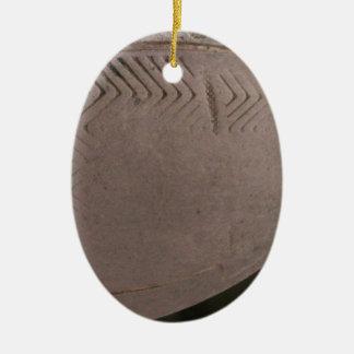 Tareas hercúleas adorno ovalado de cerámica