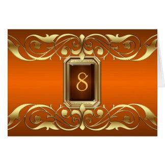 Tarjeta anaranjada de la tabla de la voluta del or