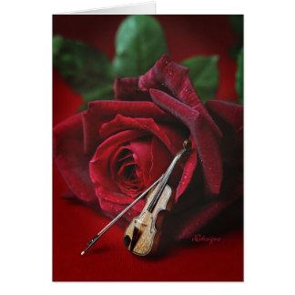 Tarjeta color de rosa y del violín