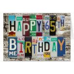 Tarjeta de cumpleaños feliz de las placas 65.a