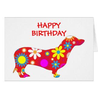 Tarjeta de cumpleaños floral enrrollada del perro