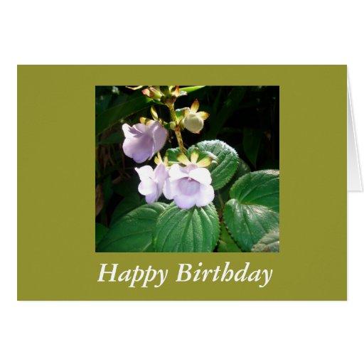 Tarjeta de cumpleaños púrpura tropical de la orquí