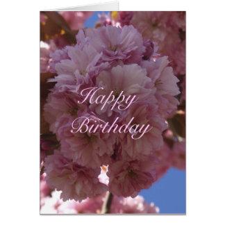 Tarjeta de cumpleaños rosada de la flor de cerezo