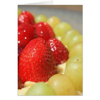 Tarjeta de felicitación de las fresas y de las uva