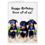Tarjeta de felicitación de los perritos del Doberm