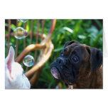 Tarjeta de felicitación de los perros y de las bur