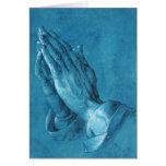 Tarjeta de felicitación de rogación de las manos d