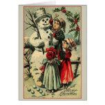 Tarjeta de felicitación del navidad del muñeco de