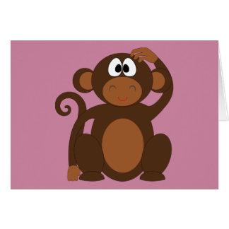 Tarjeta de felicitación enrrollada del mono