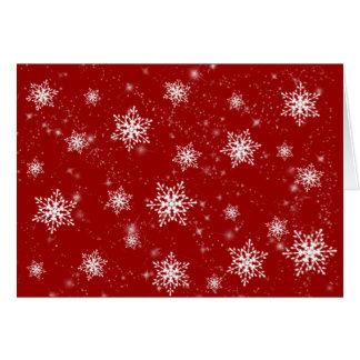 Tarjeta de felicitación roja de los copos de nieve