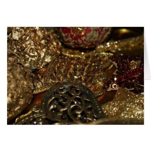 Tarjeta de las decoraciones de Navidad del oro