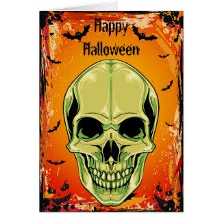 Tarjeta de mueca verde de Halloween del cráneo y