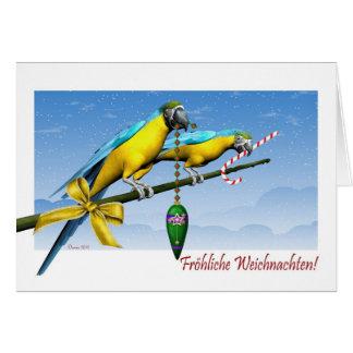Tarjeta de Navidad alemana del Macaw de Fröhliche