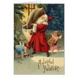 Tarjeta de Navidad con el vintage Santa y los ánge