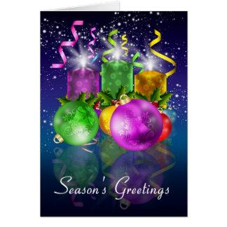 Tarjeta de Navidad con las chucherías y las velas