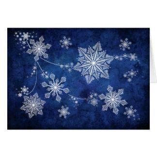 Tarjeta de Navidad de los copos de nieve que