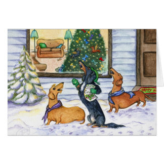 Tarjeta de Navidad de los Dachshunds de Caroling