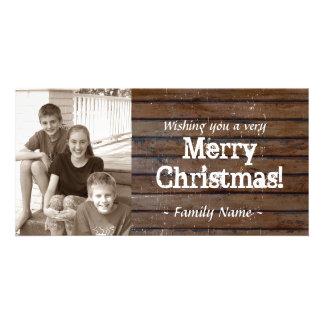 Tarjeta de Navidad de madera oscura de la foto Tarjeta Fotografica